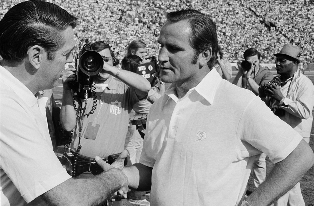 . Washington Redskins\' coach George Allen, left, and Miami Dolphins\' coach Don Shula, shakes hands on the field before the start of Super Bowl game at the Los Angeles Coliseum, Jan. 14, 1973. (AP Photo)