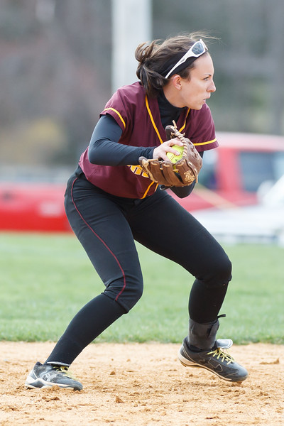 Sheehan's Meghan Gavin (11) turns to first to throw out Amity's Amanda Rieser (5) Thursday at Amity Regional High School in Woodbridge Apr. 23, 2015 | Justin Weekes / For the Record-Journal