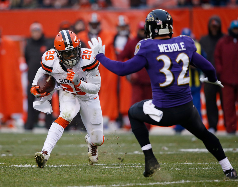 . Baltimore Ravens defensive back Marlon Humphrey (29) tries to avoid Baltimore Ravens free safety Eric Weddle (32) during the second half of an NFL football game, Sunday, Dec. 17, 2017, in Cleveland. (AP Photo/Ron Schwane)