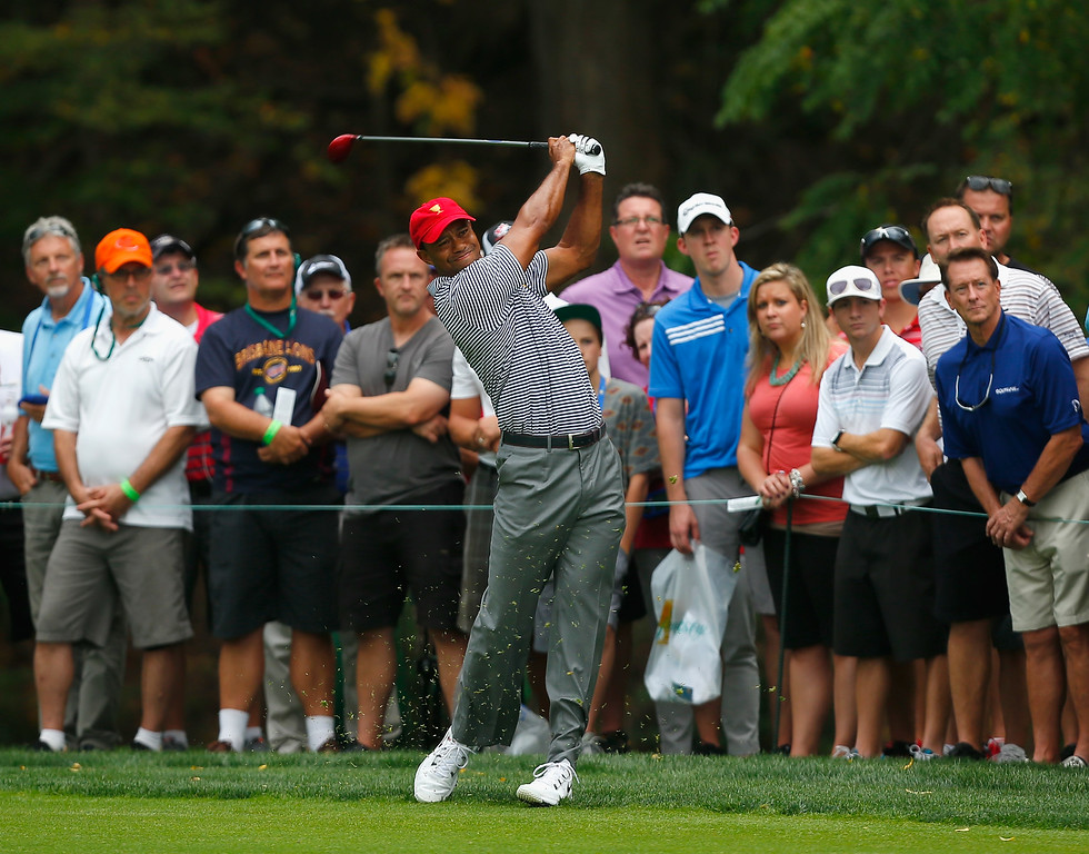. DUBLIN, OH - OCTOBER 04:  Tiger Woods of the U.S. Team hits his second shot on the fifth hole during the Day Two Foursome Matches at the Muirfield Village Golf Club on October 4, 2013  in Dublin, Ohio.  (Photo by Matt Sullivan/Getty Images)