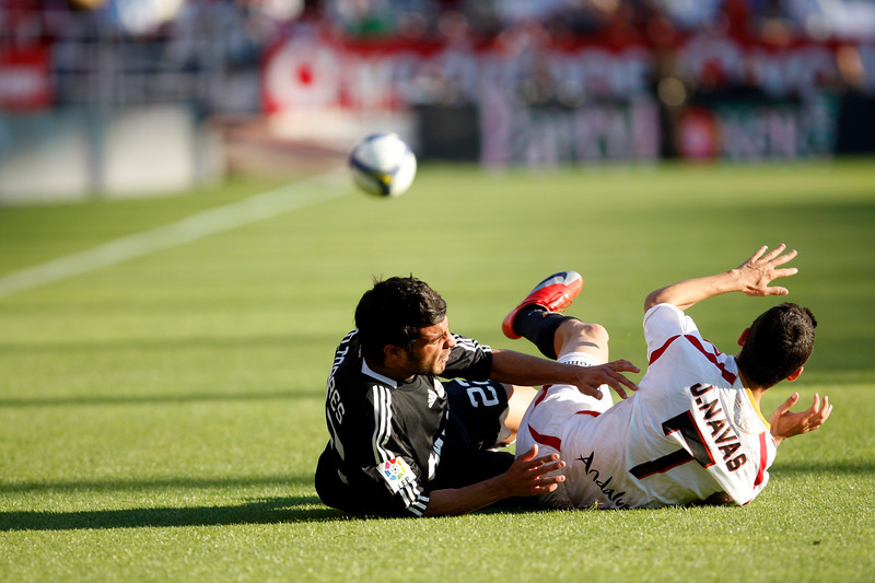 Miguel Torres (R. Madrid, left) and Jesus Navas (Sevilla, right) falling down. Spanish Liga football game between Sevilla FC and Real Madrid CF that took place at Sanchez Pizjuan stadium, Seville, Spain, on 26 April 2009