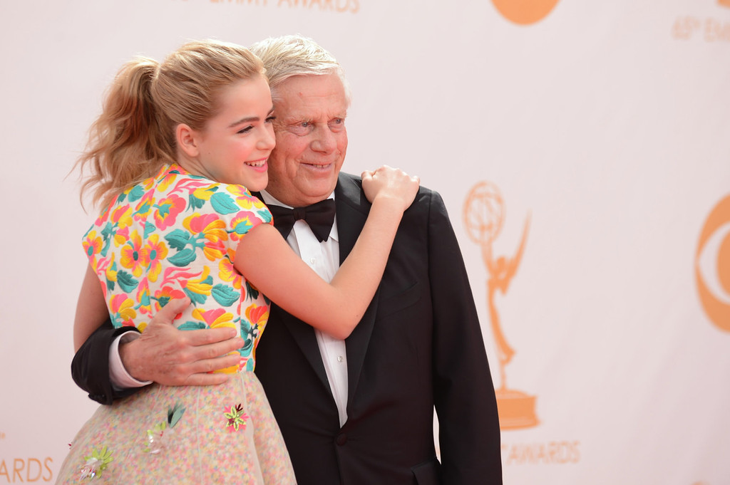. Kiernan Shipka and Robert Morse arrive at the 65th Primetime Emmy Awards at Nokia Theatre on Sunday, Sept. 22, 2013, in Los Angeles.  (Photo by Jordan Strauss/Invision/AP)