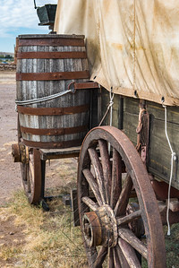 Close up view of wooden barrel attached of a covered wagon
