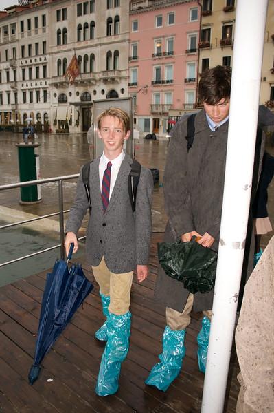Harry and Teddy making their way to the vaporetto through the Aqua Alta