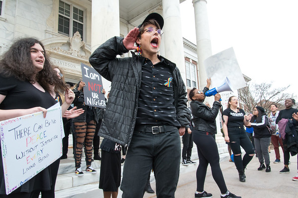 04/11/19 Wesley Bunnell | Staff CCSU students and some faculty gathered to protest the recent vandalism on campus where racist remarks were spray painted on campus property. CCSU student Armando Orsorio helps lead protest chants near the steps of Davidson Hall .