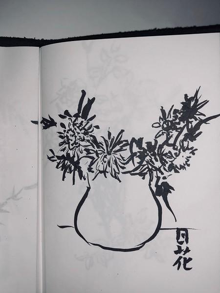 brush pen sketch in notebook