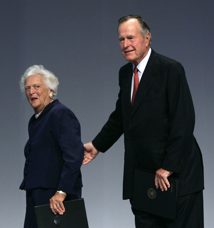 . Former President George Bush, right, walks with former first lady Barbara Bush after delivering a speech to the International Union Against Cancer World Cancer Congress, Saturday, July 8, 2006 in Washington. Bush and his wife, Barbara, lost a child to cancer 53 years ago, but they\'re still fighting for cancer research and prevention. (AP Photo/Evan Vucci)