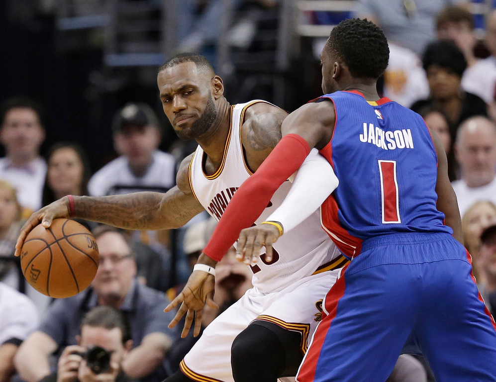 . Cleveland Cavaliers\' LeBron James (23) drives past Detroit Pistons\' Reggie Jackson (1), from Italy, in the second half in Game 1 of a first-round NBA basketball playoff series, Sunday, April 17, 2016, in Cleveland. The Cavaliers won 106-101. (AP Photo/Tony Dejak)