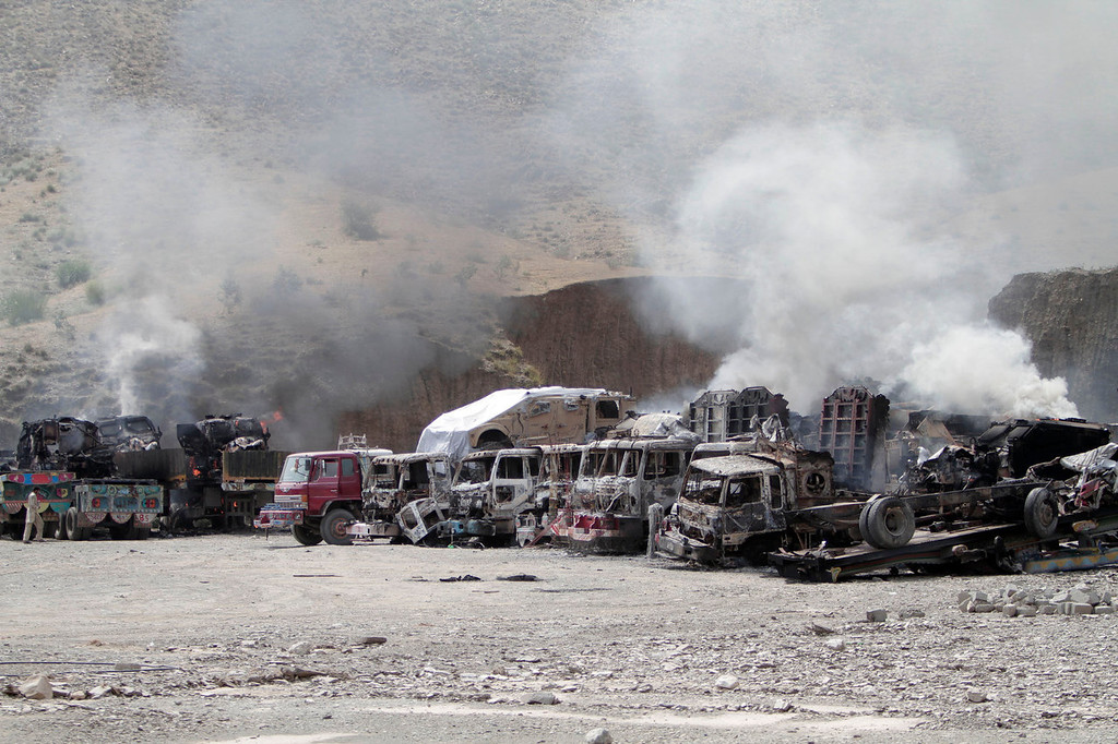 . NATO supply trucks burn following an attack by militants on a U.S. base in the Torkham area near the Pakistan-Afghanistan border east of Kabul, Afghanistan, Monday, Sept. 2, 2013. The Taliban claimed responsibility for the strike on a U.S. base in Afghanistan near the border with Pakistan on Monday, setting off bombs, torching vehicles and shutting down a key road used by NATO supply trucks, officials said. Several people -- apparently all attacking insurgents -- were killed.   (AP Photo/Rahmat Gul)