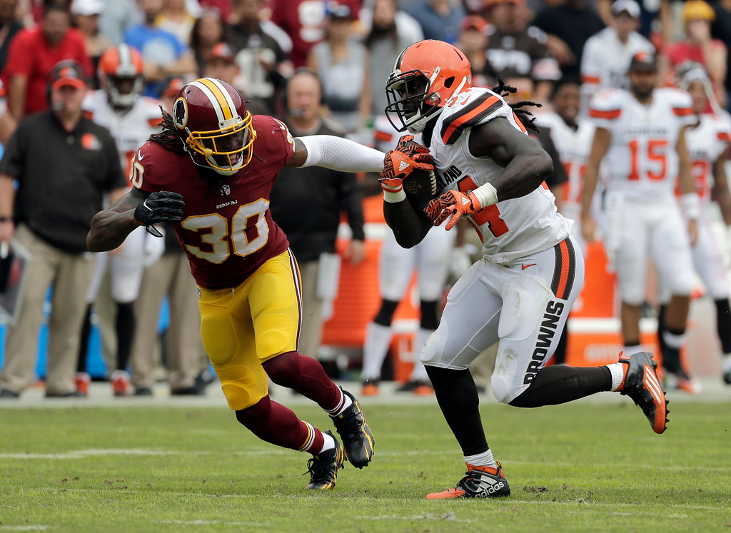 . Washington Redskins strong safety David Bruton (30) tackles Cleveland Browns running back Isaiah Crowell (34) during the first half of an NFL football game Sunday, Oct. 2, 2016, in Landover, Md. (AP Photo/Chuck Burton)