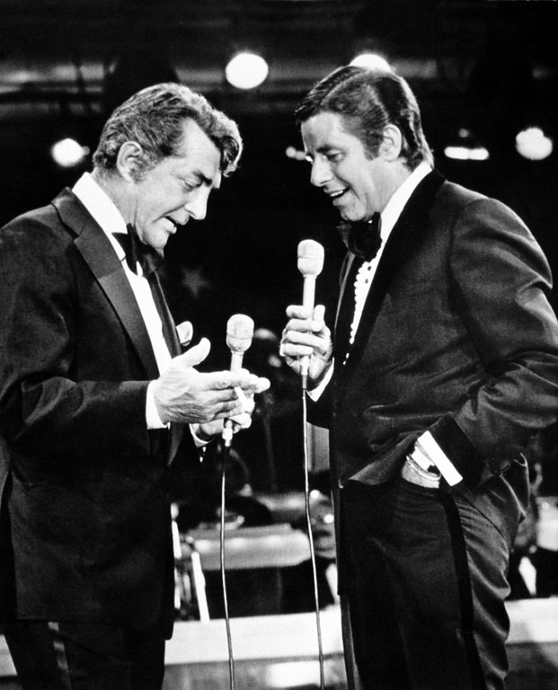 . FILE - In this Sept. 7, 1976, file photo, entertainers Dean Martin, left, and Jerry Lewis appear together on Lewis\'s annual telethon for the Muscular Dystrophy Association in Las Vegas, Nev. Lewis, the manic, rubber-faced showman who jumped and hollered to fame in a lucrative partnership with Martin, settled down to become a self-conscious screen auteur and found an even greater following as the tireless, teary host of the annual muscular dystrophy telethons, has died. He was 91. His publicist said Lewis died Sunday, Aug. 20, 2017. (AP Photo/File)