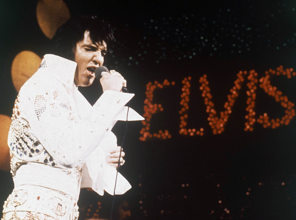 . FILE - This 1972 file photo shows Elvis Presley during a performance. The AP reported on July 14, 2017, that a story claiming a dead homeless man in San Diego was identified as Presley is a hoax. Presley died in 1977. (AP Photo, File)