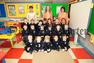 New Primary 1 pupils at St Joseph's PS Bessbrook. Pictured with the pupils are Teacher Catherine Murray along with Classroom Assistants Patricia O'Hanlon and Josephine Burns. R1338018