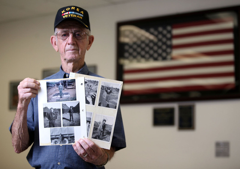 Don Heeter, Korean War veteran, poses with photographs he took from his experiences in the war before an interview at the Chico Veteran's Memorial Hall Wednesday, July 24, 2013 in Chico, Calif. The armistice, signed on July 27, 1953, will have it's 60 year anniversary Saturday.  (Jason Halley/Chico Enterprise-Record)