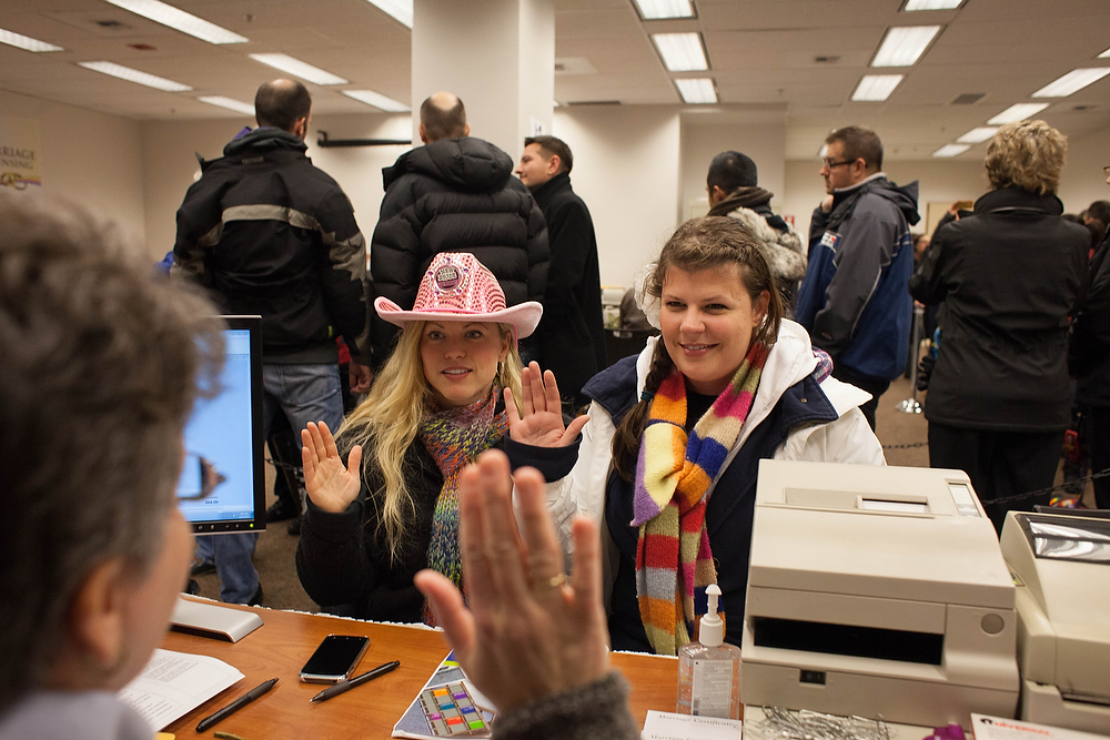 ". Just after 3:00 a.m., Corrinalyn and Jennifer Guyette apply for a marriage license at the King County Recorder\'s Office on December 6, 2012 in Seattle, Washington. ""It was so great,\"" said Corrinalyn. The two have been together for six years. The office opened at 12:01 a.m. to begin issuing marriage licenses to same-sex couples for the first time after Washington voters chose to legalize gay marriage in November\'s election. (Photo by David Ryder/Getty Images)"