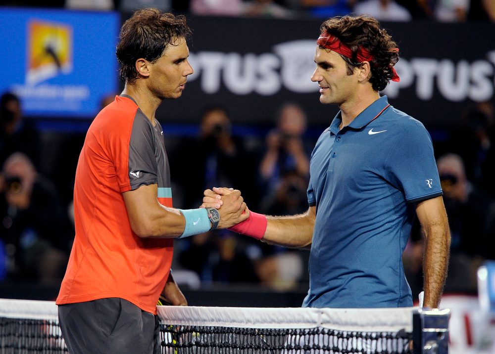 . Rafael Nadal of Spain, left, is congratulated by Roger Federer of  Switzerland at the net after Nadal won their semifinal final at the Australian Open tennis championship in Melbourne, Australia, Friday, Jan. 24, 2014. (AP Photo/Andrew Brownbill)