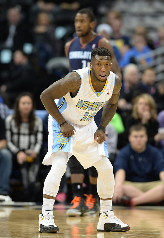 . Nate Robinson of the the Denver Nuggets (10) is in the first quarter of the game against the Charlotte Bobcats at Pepsi Center. Denver. Colorado. January 29. 2014. (Photo by Hyoung Chang/The Denver Post)
