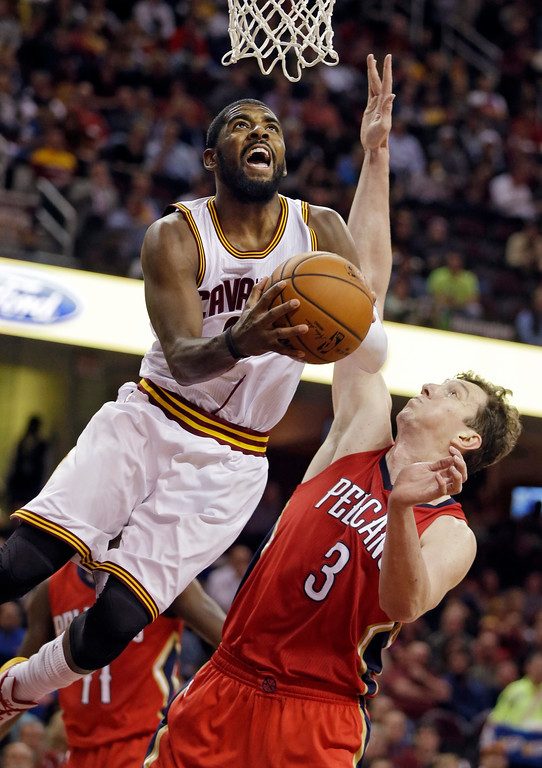 . Cleveland Cavaliers\' Kyrie Irving puts up a shot against New Orleans Pelicans\' Omer Asik (3), from Turkey, in the third quarter of an NBA basketball game Monday, Nov. 10, 2014, in Cleveland. Irving scored 32 points in a 118-111 win over New Orleans. (AP Photo/Mark Duncan)