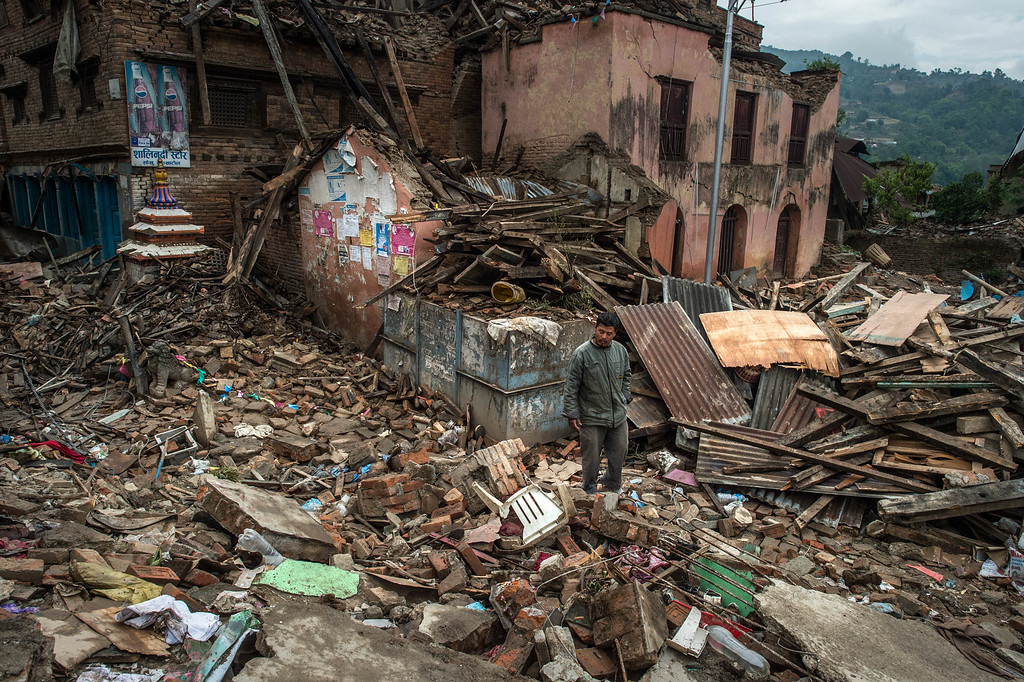 . A Nepalese victim of the earthquake walks among debris of collapsed buildings in Shankhu on April 30, 2015 in Kathmandu, Nepal. A major 7.8 earthquake hit Kathmandu mid-day on Saturday, and was followed by multiple aftershocks that triggered avalanches on Mt. Everest that buried mountain climbers in their base camps. Many houses, buildings and temples in the capital were destroyed during the earthquake, leaving over 5500 dead and many more trapped under the debris as emergency rescue workers attempt to clear debris and find survivors. Regular aftershocks have hampered recovery missions as locals, officials and aid workers attempt to recover bodies from the rubble.  (Photo by David Ramos/Getty Images)