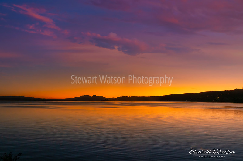 The Central Plateau volcanos after sunset  as seen from Taupo