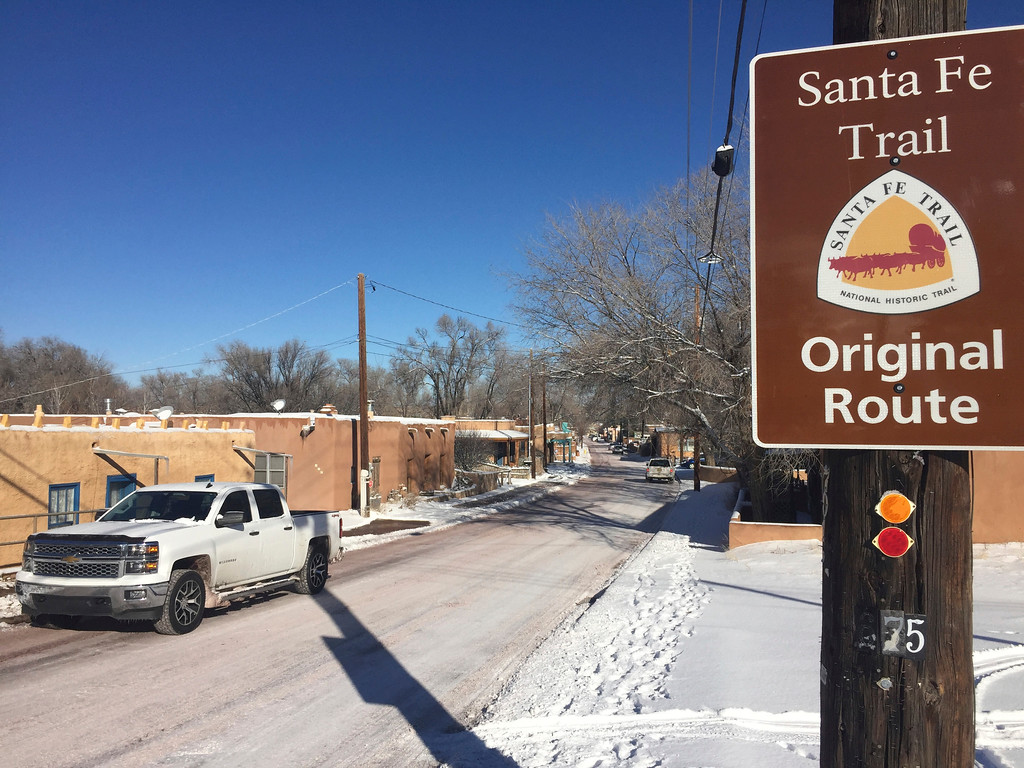 . Residents of Santa Fe, N.M, commute across icy roads on Friday, Jan. 6, 2017, after a winter storm closed schools and blanketed nearby ski resorts with snow. Authorities reported difficult driving conditions on the New Mexico\'s two main interstate highways.(AP Photo/Morgan Lee)