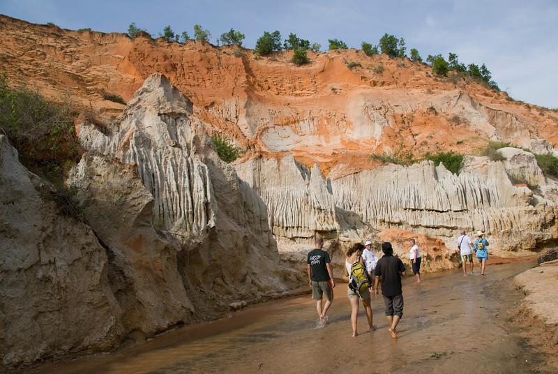 Tourists walking down stream near cliffs- Mui Ne, Vietnam