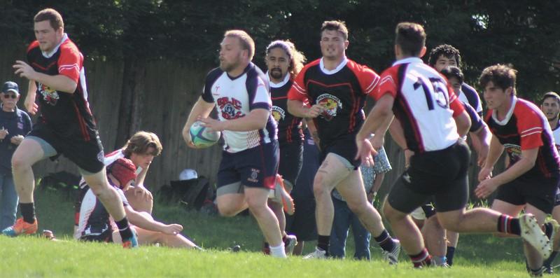 beasley eunning with the ball brian on ground.jpg