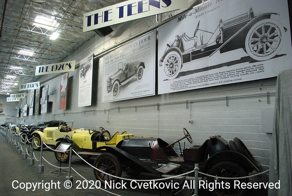 Older street cars that were raced are along one wall