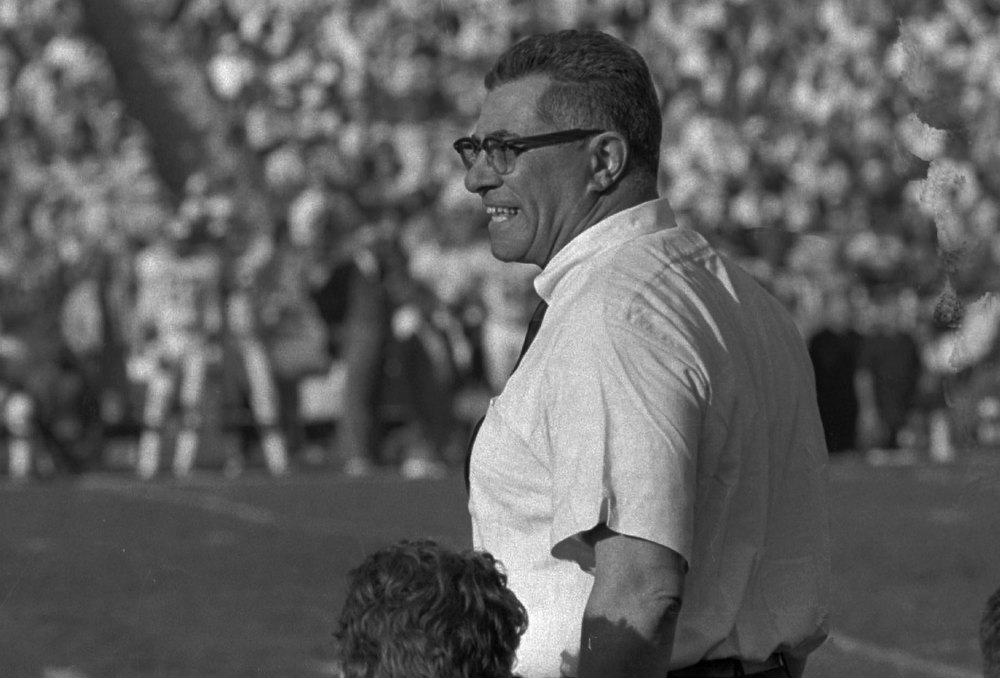 Description of . Coach Vince Lombardi cheers on his champion Green Bay Packers Jan. 15,1967 as they swamp the Kansas City Chiefs 35 to 21 in  Super Bowl I, in Los Angeles. (AP Photo/Stf)