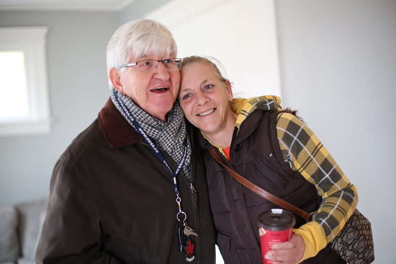 Marilynn Harcus thanks Michael Rovers for helping her move into a new apartment.