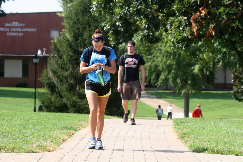 Students on the campus of Gardner-Webb University walking to class on a fall day.