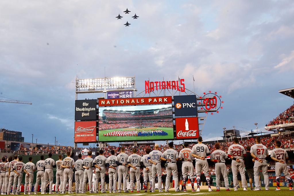 . American League players watch the fly over during the Major League Baseball All-star Game, Tuesday, July 17, 2018 in Washington. (AP Photo/Patrick Semansky)