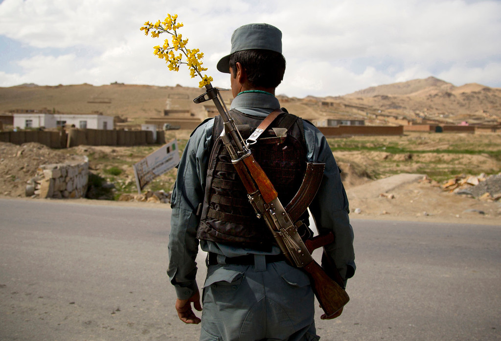. In this Wednesday, May 15, 2013 file photo made by Associated Press photographer Anja Niedringhaus, an Afghan National Police officer mans a checkpoint in the outskirts of Maidan Shahr, Wardak province, Afghanistan.  (AP Photo/Anja Niedringhaus, File)