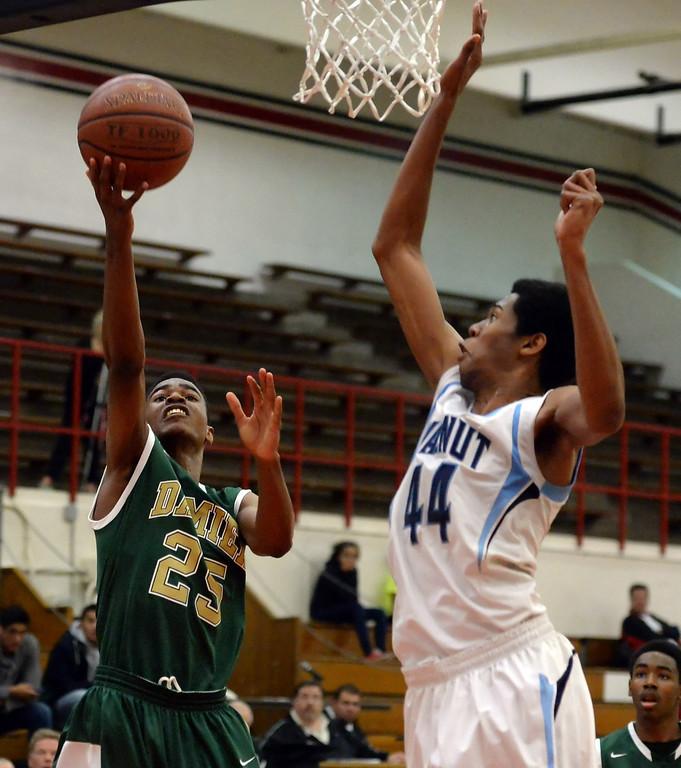 . Damien\'s Micah Robinson (25) drives to the basket against Walnut\'s Richard Rycraw (C) (44) in the first half of the Glendora basketball tournament at Glendora High School in Glendora, Calif., on Friday, Dec. 13, 2013. Damien won 66-60.  (Keith Birmingham Pasadena Star-News)