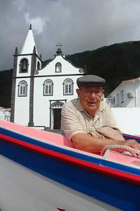 José Lourenço Azevedo (Ribeiras, Pico), born 1916, pictured with a renovated whaling boat in the Ribeiras harbor. August 15, 2012.