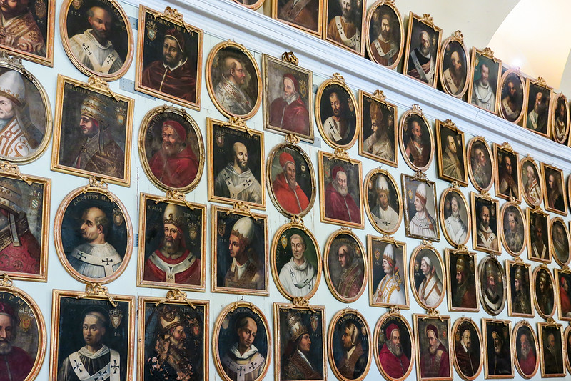wall with gallery of popes through the years