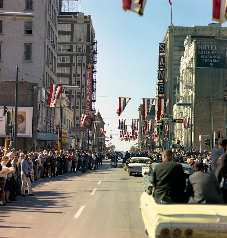 . Kennedy\'s motorcade travels through downtown Dallas. Cecil Stoughton/John F. Kennedy Presidential Library and Museum