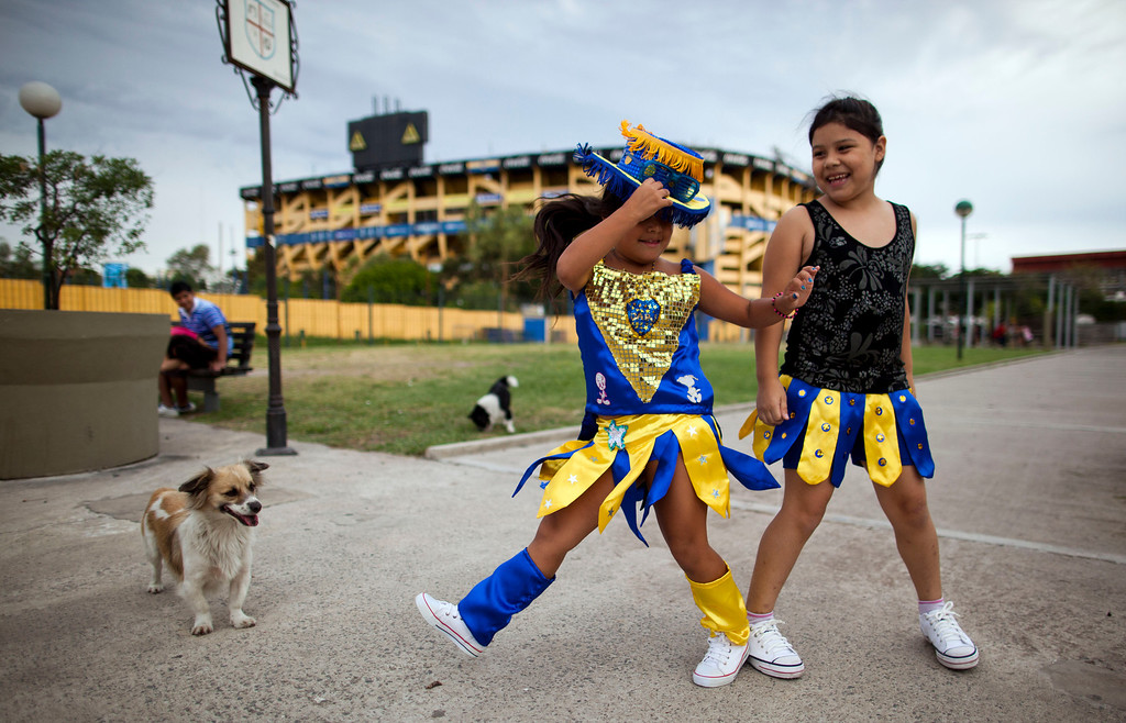 ". Girls, members of the murga ""Los amantes de La Boca\"", rehearse before participating in carnival celebrations in Buenos Aires, Argentina, Saturday, Feb. 2, 2013. Members of the murga \""Los amantes de La Boca\"" rehearse before participating in carnival celebrations in Buenos Aires, Argentina, Saturday, Feb. 2, 2013. Argentinians\' carnival celebrations may not be as well-known as the ones in neighboring Uruguay and Brazil, but residents of the nation\'s capital are equally passionate about their \'murgas,\' or traditional musical troupes. The murga \""Los amantes de La Boca\"" or \""The Lovers of The Boca\"" is among the largest, with about 400 members. It\'s a reference to the hometown Boca Juniors, among the most popular soccer teams in Argentina and the world. (AP Photo/Natacha Pisarenko)"