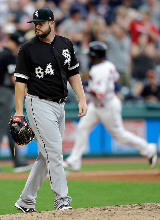 . Chicago White Sox starting pitcher David Holmberg, left, waits for Cleveland Indians\' Edwin Encarnacion, right, to run the bases after Encarnacion hit a two-run home run in the fourth inning of a baseball game, Saturday, June 10, 2017, in Cleveland. Michael Brantley also scored on the play. (AP Photo/Tony Dejak)
