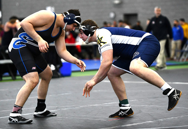 2/29/2020 Mike Orazzi | StaffrBristol Eastern's Nicholas St. Peter and Haddam-Killingworth's Thomas Perry during the CIAC 2020 State Open Wrestling Tournament at the Floyd Little Athletic Center in New Haven.rrrr r