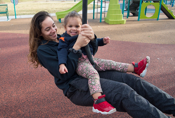01/10/20 Wesley Bunnell | StaffrrKaishia Thompson rides on a swing with her daughter Evangelina, age 2, on Friday January 10th at Chesley park while taking advantage of the mild weather .