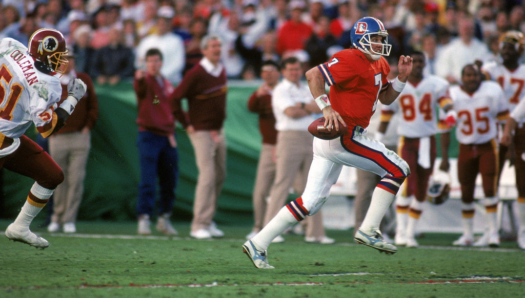 . Quarterback John Elway #7 of the Denver Broncos scrambles for yards during Super Bowl XXII against the Washington Redskins at the Jack Murphy Stadium on January 31, 1988 in San Diego, California.    (Photo by George Rose/Getty Images)