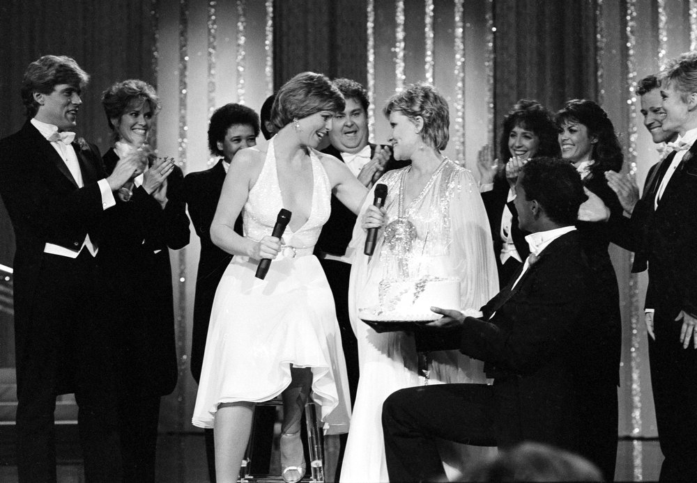 ". Guest star Patti Page, right, is presented with a surprise birthday cake on the set of ""Music of Your Life\"" as host and singer Toni Tennille congratulates the singer in this undated photo.  (AP Photo)"