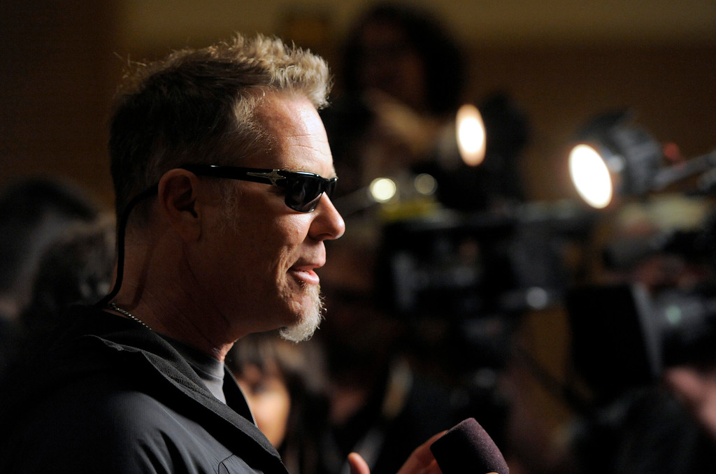 """. James Hetfield, of musical group Metallica, speaks to media at the \""""Metallica Through the Never\"""" press line on Day 3 of Comic-Con International on Friday, July 19, 2103 in San Diego, Calif. (Photo by Chris Pizzello/Invision/AP)"""