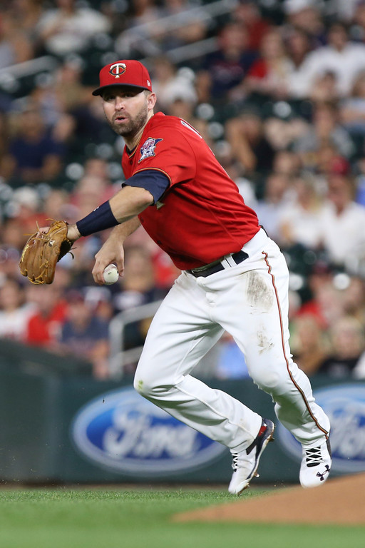 . Minnesota Twins\' Brian Dozier looks to throw the ball against the Cleveland Indians in the sixth inning of a baseball game Monday, July 30, 2018 in Minneapolis. Minnesota won 5-4. (AP Photo/Stacy Bengs)
