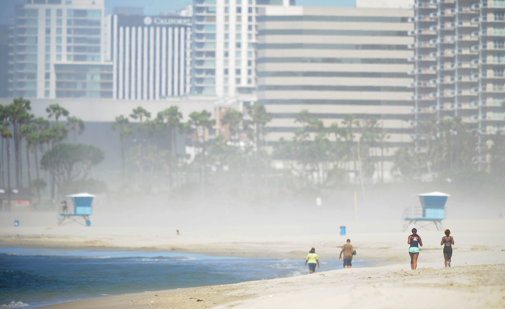. Hot Santa Ana winds kick up the sand along the beach in Long Beach, CA on Tuesday, May 13, 2014. The blowing sand kept many away from the beach where only a few people gathered in the late morning. (Photo by Scott Varley, Daily Breeze)