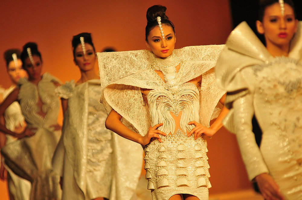 . Models showcases designs from the Grand Allure collection by various designers on the runway at the last day of the Philippine Fashion Week Holiday 2013 on May 26, 2013 in Manila, Philippines.  (Photo by Veejay Villafranca/Getty Images)