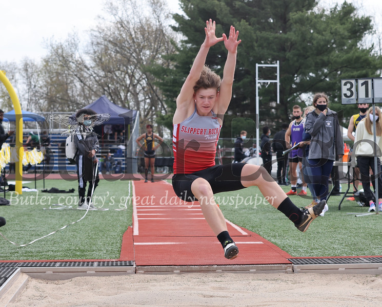 Slippery Rock's Ethan Folmer competes in the triple jump in Friday's Butler Track and Field Invitational. Folmer finished second in the event. Seb Foltz/Butler Eagle 04/23/21