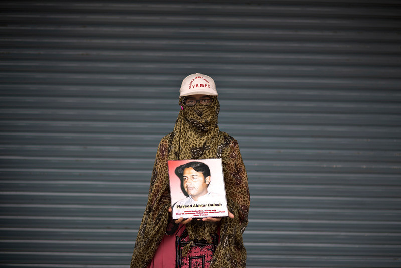 . Maheen Baloch, 15, poses for a portrait holding a photograph of her brother Naveed, who went missing on August 17, 2013, while she and other relatives take a break from a long march protest, in Rawalpindi, Pakistan, Friday, Feb. 28, 2014. She is part of a group of activists from the impoverished southwestern province of Baluchistan who walked roughly 3,000 kilometers (1,860 miles) to the capital of Islamabad to draw attention to alleged abductions of their loved ones by the Pakistani government. (AP Photo/Muhammed Muheisen)