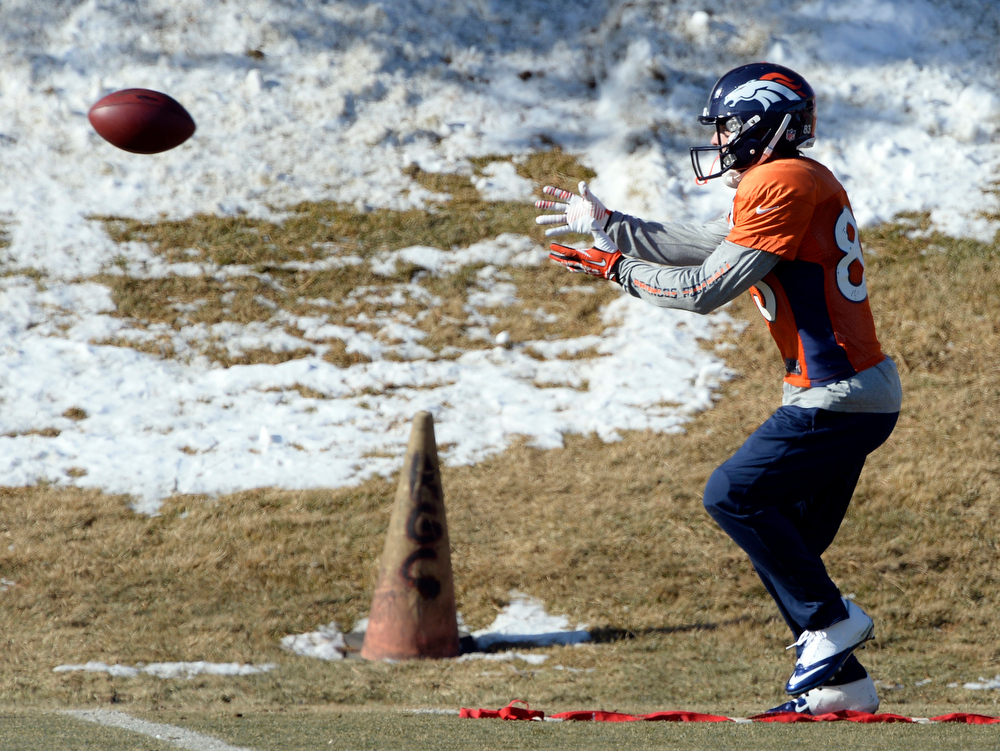 . Denver Broncos wide receiver Wes Welker (83) catches a pass during practice January 8, 2014 at Dove Valley. The Denver Broncos are preparing for their Divisional Game against the San Diego Chargers at Sports Authority Field. (Photo by John Leyba/The Denver Post)